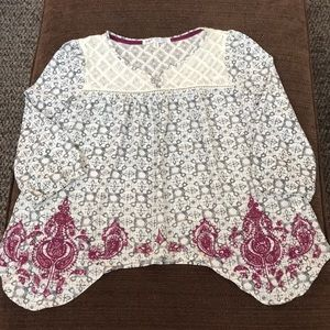 Jolt asymmetrical hem embroidered blouse. Small